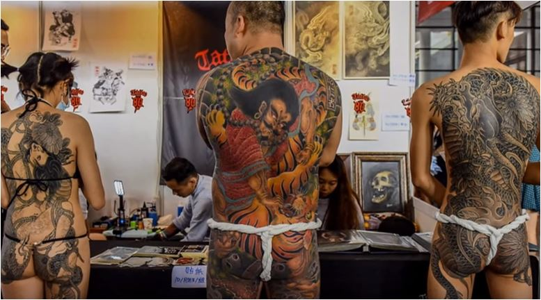 Tattoo- fans -show- off- their -extreme bodywork- at international -festiva-l in- China celebrating- the- art